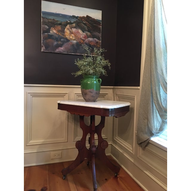 Victorian marble top accent table from home in Upstate NY. Pedestal stand with castors.