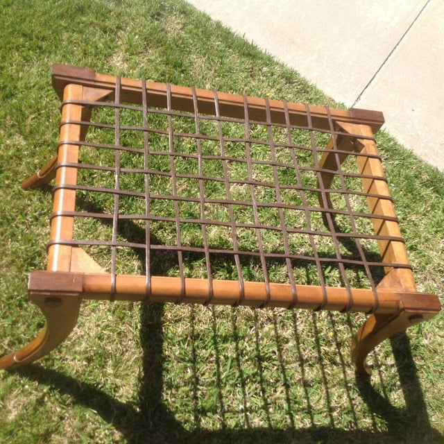 Mid century style Klismos bench. The bench is in excellent condition . The wood is stained walnut and has a leather...