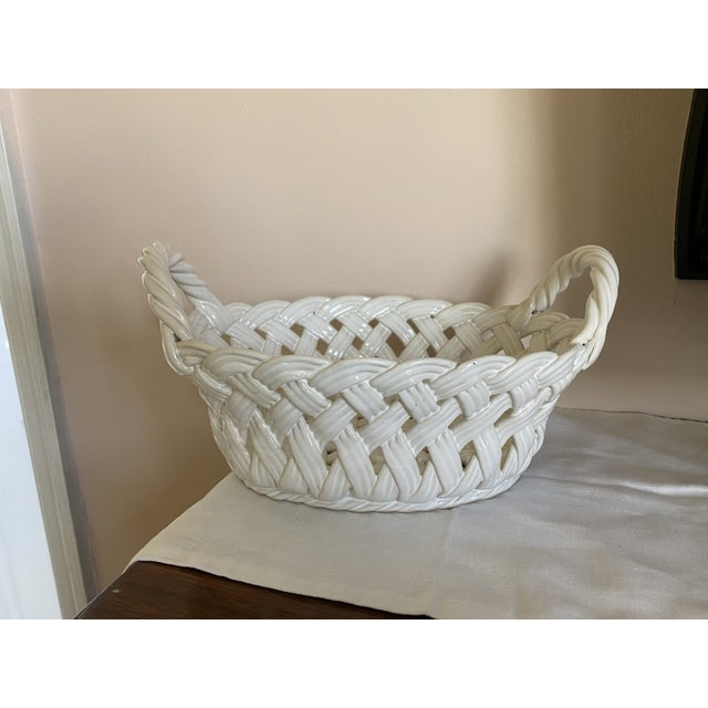 This is a beautiful white ceramic open-weave handled oval basket made c. 1990 in Portugal. It is marked on the bottom...