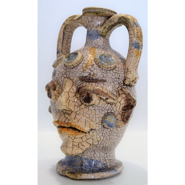 Offering a vintage 1960s ceramic Raku vase with an abstract face done in the style of Pablo Picasso. This amazing off-...