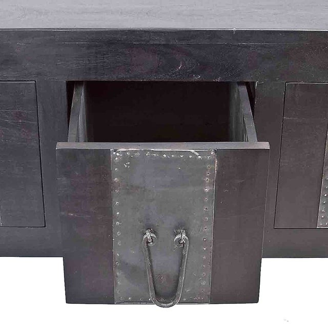 This rustic but modern ebony-finish console with four drawers, is handcrafted out of teak wood, with metal iron pulls and...