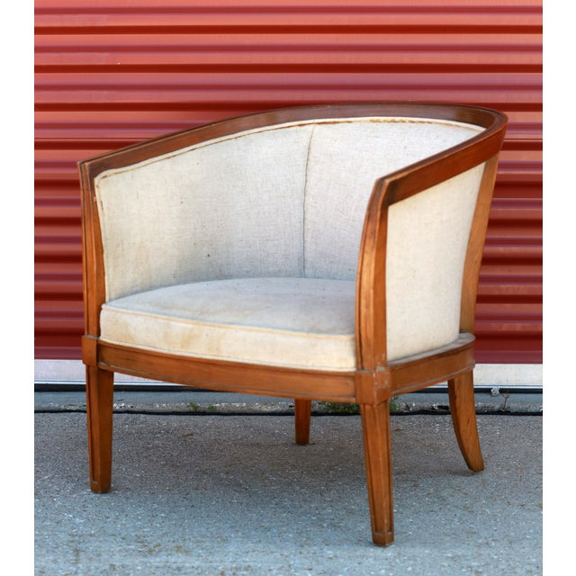 This small scale club chair has inviting and elegant deco lines. It has ties to the Neoclassical style, but has been...
