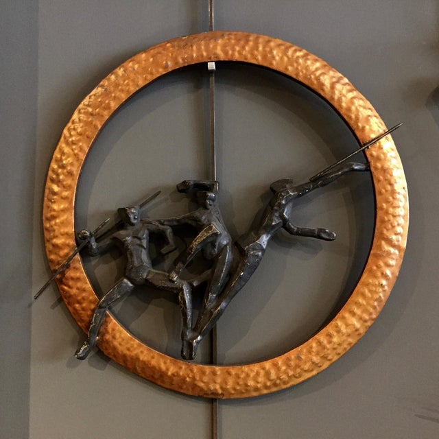 A rare find in a set of three wall sculptures from the 1930s depicting three olympic events; javelin, fencing and hurdles...