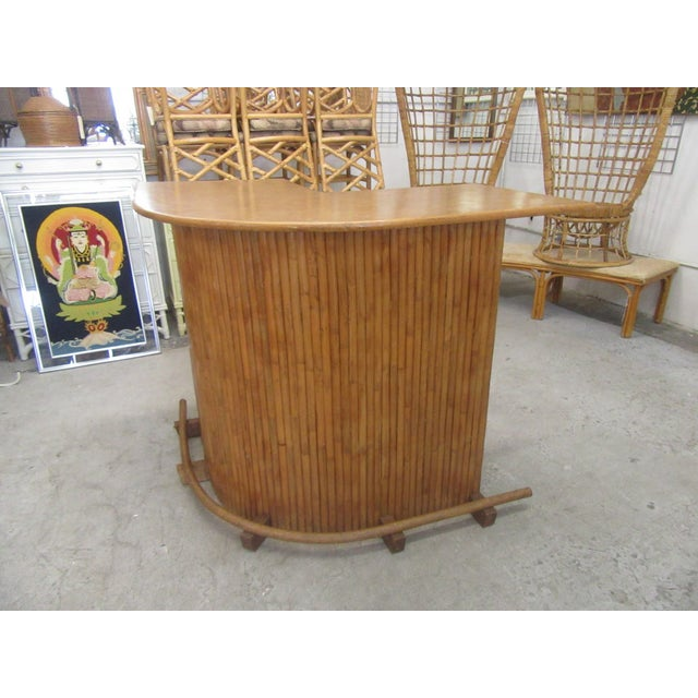 """Island style vintage bamboo bar. It measures 43"""" H x 69"""" W x 25""""D. IT is in good as found vintage condition."""