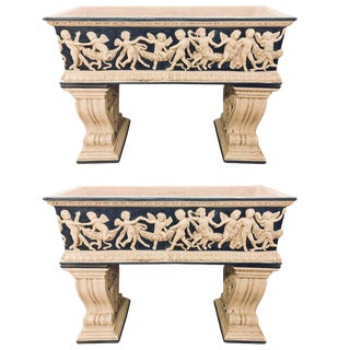 Pair of Neoclassical Style Ceramic Planter Tops Depicting Cherubs Dancing For Sale