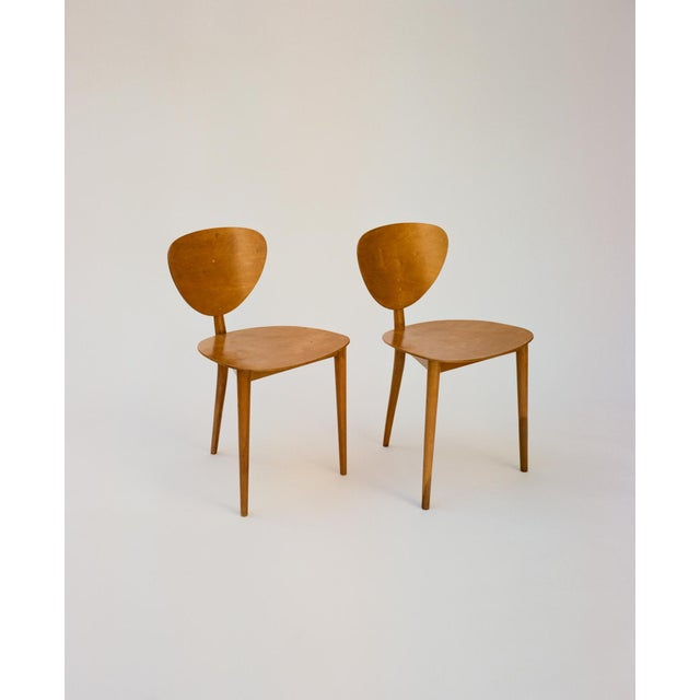 """A pair of Tripod chairs (""""Dreibeinstuhl"""") by Max Bill designed in 1949, produced by Swiss manufacturer AG Möbelfabrik..."""