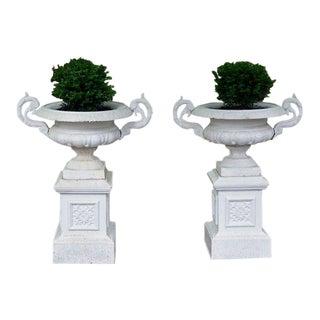 Cast-iron urns on pedestals