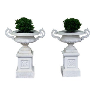 Cast-iron urns on pedestals- A Pair For Sale