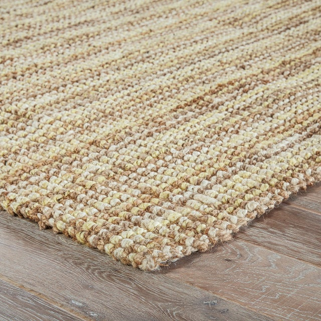 This natural jute area rug offers a neutral foundation to transitional homes. With a texture-rich chunky weave, this...