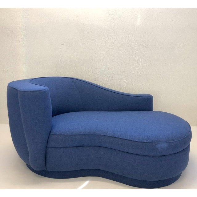 """A spectacular """"Corkscrew"""" chaise lounge attributed to Vladimir Kagan in the 1990s. The chaise is upholstered in a blue..."""