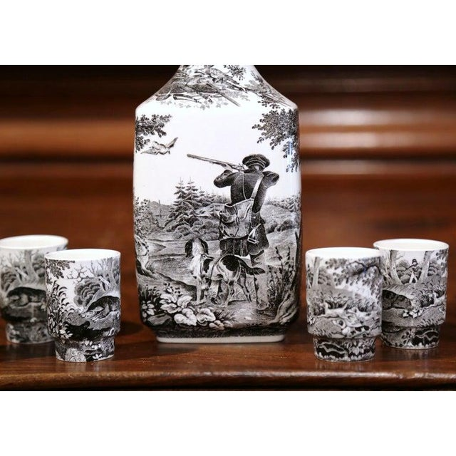 This elegant, porcelain liquor set was crafted in Germany in 1950, and features a hunting scene in a traditional, European...