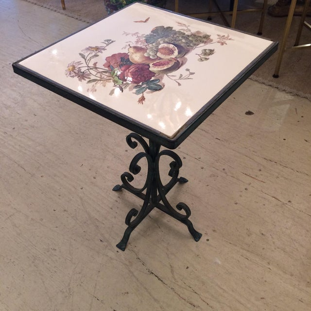 Charming small drinks table or side table having a beautiful tile top hand painted with fruit and flowers, sitting on a...