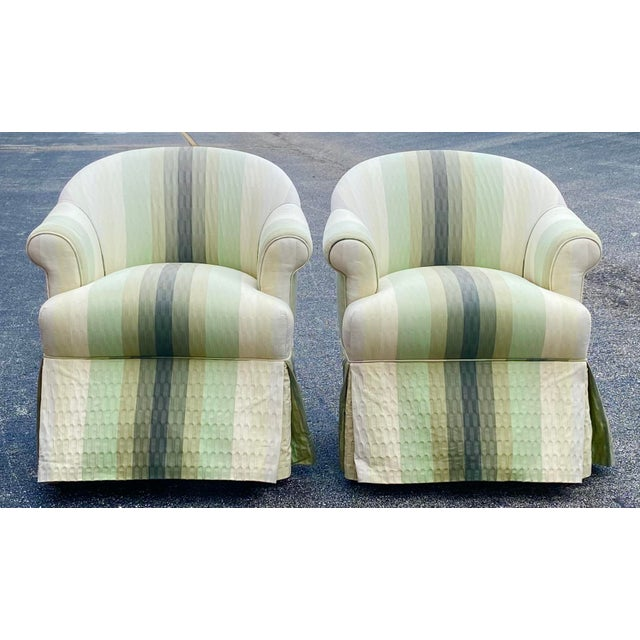 Fabulous pair of R. Jones of Dallas club chairs. Beautiful shades of green stripes run the length of the chair. Acquired...