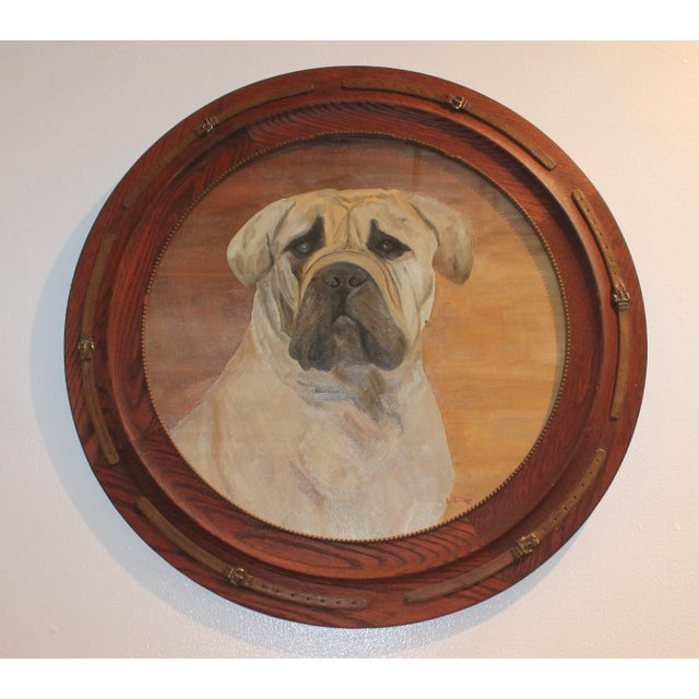 This beautiful oil painting is accentuated by a custom frames with wooden dog collars circling the painting that are...