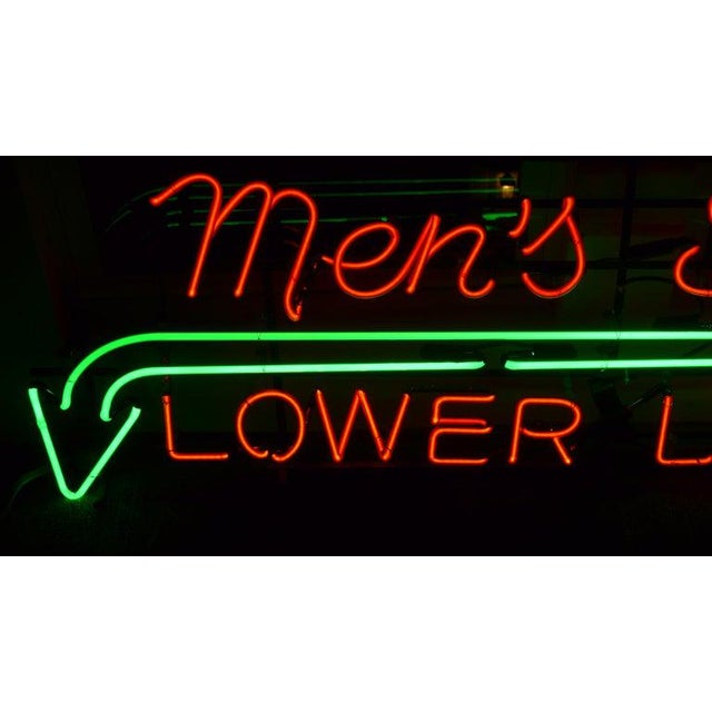Neon signage from a midwestern department store directing customers to: Men's Shoes, Lower Level, circa 1930s. Strikingly...