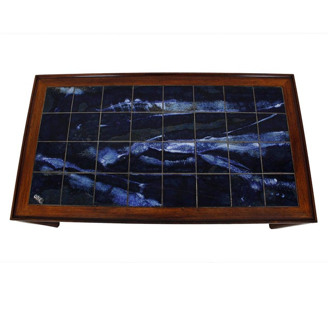 Due to the tile top, this striking coffee table nearly eliminates the need for coasters (although we recommend always...