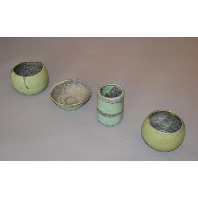 Set of 4 vintage handcrafted Aztec green, gray and brown group of pottery bowls, vessel. Makers mark underneath....