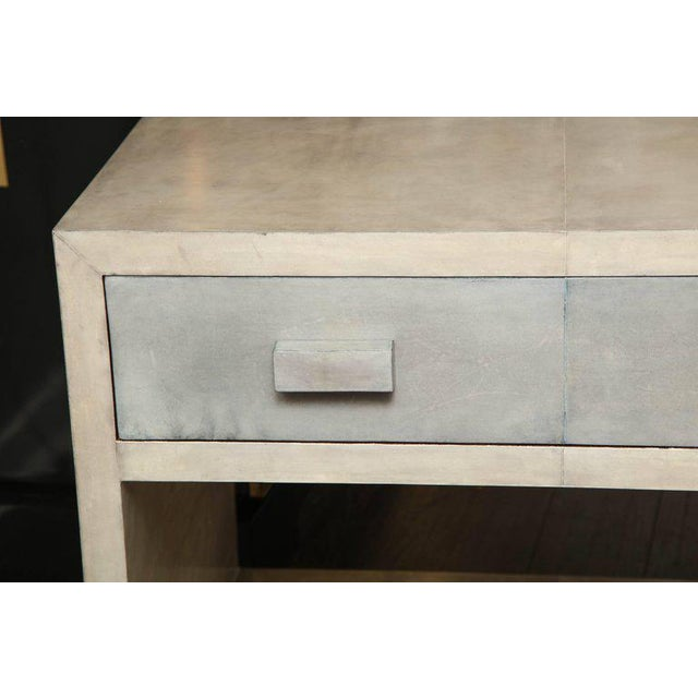 Pair of parchment two-tone nightstands.
