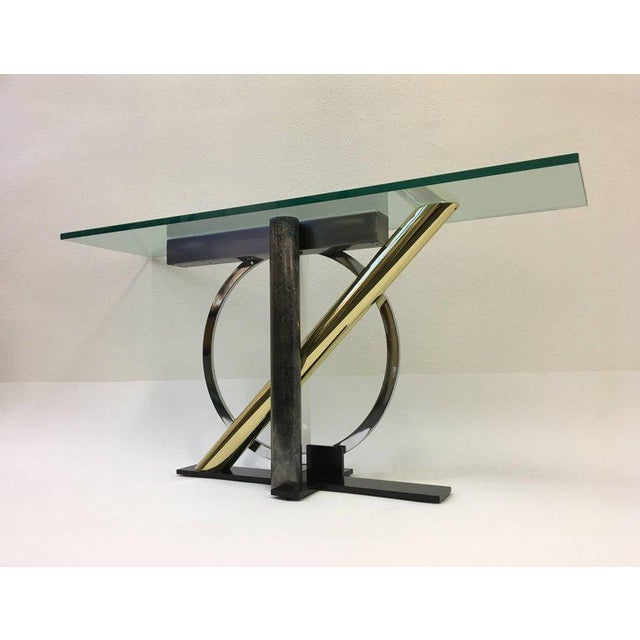 A beautiful sculptural Memphis style console table designed in the 1980s by Kaizo Oto for Design Institute of America. The...