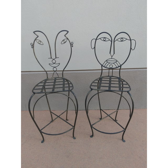 Whimsical, Funky and Fun pair of John Risley Style Figurative Man and Woman Sculptural Wrought Iron Set of bar stools In...