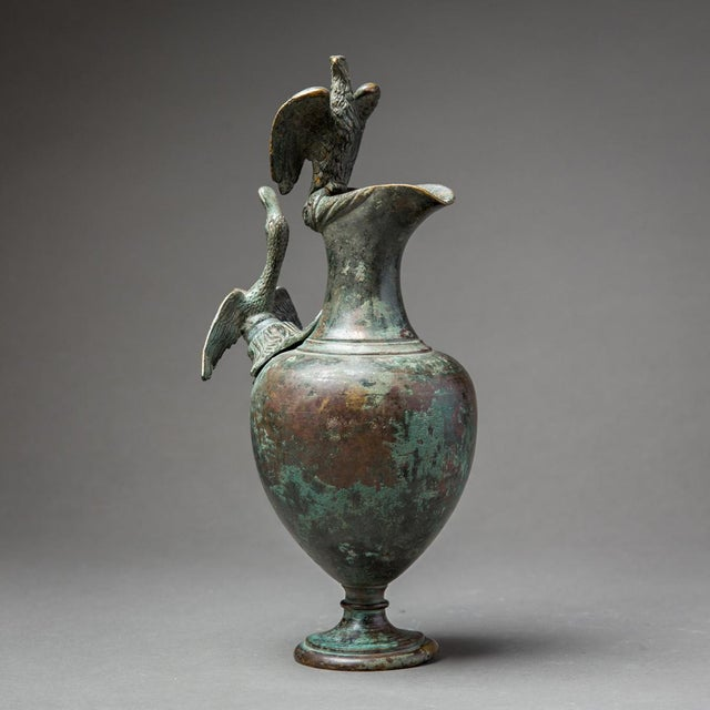 Of elegant proportions and with a pleasing dark green patina, this ewer, once used for the pouring of water, makes for a...