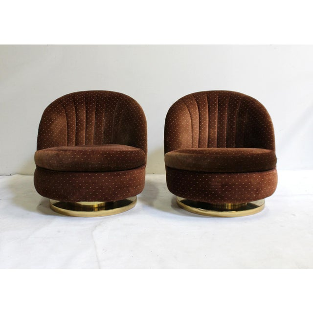 Pair of Milo Baughman for Thayer Coggin swivel and rock lounge chairs from the 1970s with original tag and upholstery....