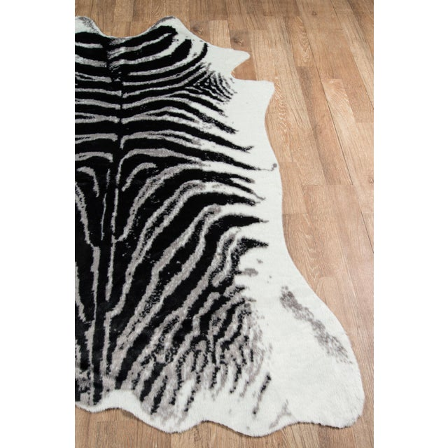 The safari style of this decorative area rug collection is artfully crafted with humane design in mind. An innovative...