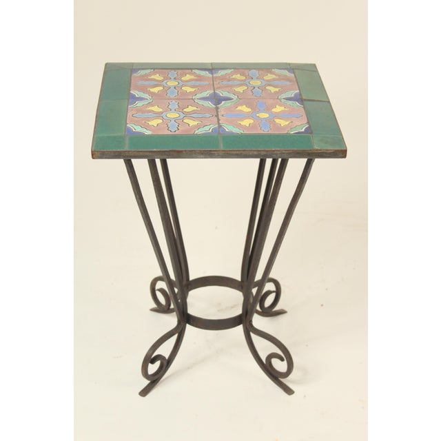 Art deco tile top and iron base occasional table, circa 1930's. The tile top is possibly Malibu.