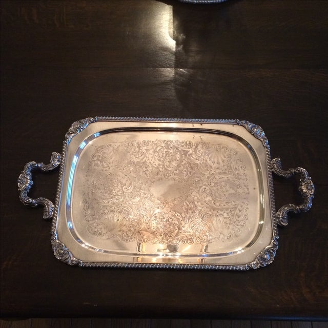 This is a wonderful rectangular serving tray with handles. The handles are very sturdy and the chasing shows slight wear....
