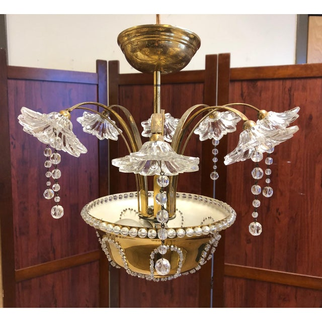 Italian Murano glass and brass chandelier. Has floral glass lights with prisms which illuminates at the base.