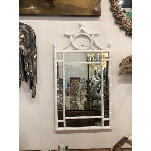 Vintage faux bamboo wall mirror. Newly, professionally lacquered in a gloss white, new mirror insert. Ready to hang.