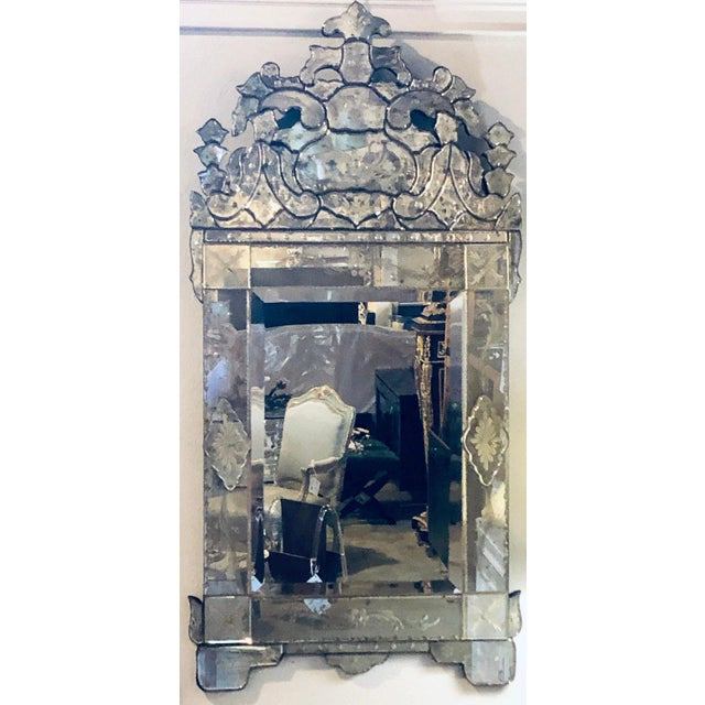 Pair of lovely Venetian style wall mirrors with beautiful etching in glass. The center panel is a clear mirror framed in a...
