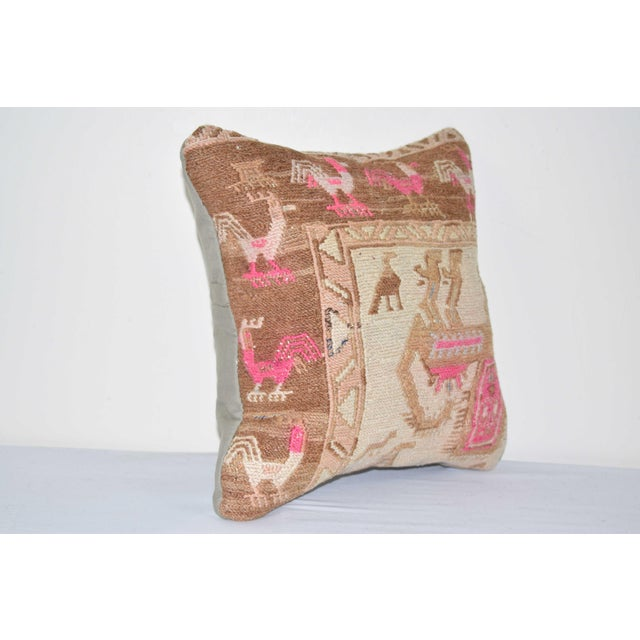 """These beautiful 14"""" x 14"""" pillow covers were made from an authentic, vintage Turkish rug handwoven in the 1960s. Bright..."""