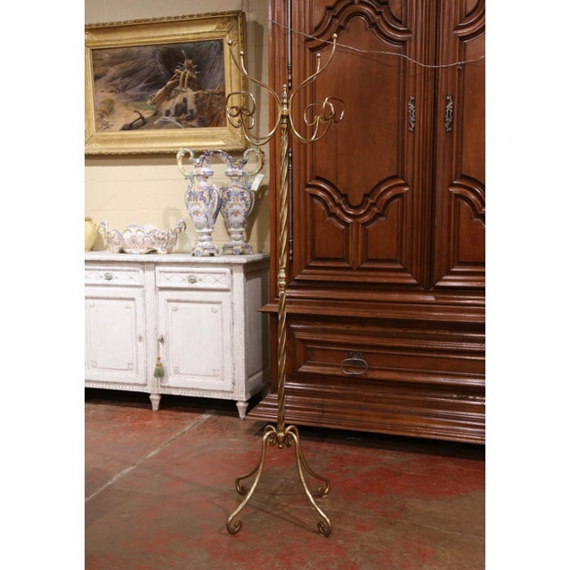 Crafted in France circa 1950, the tall antique rack stands on four scrolled legs over a twisted stem embellished with...