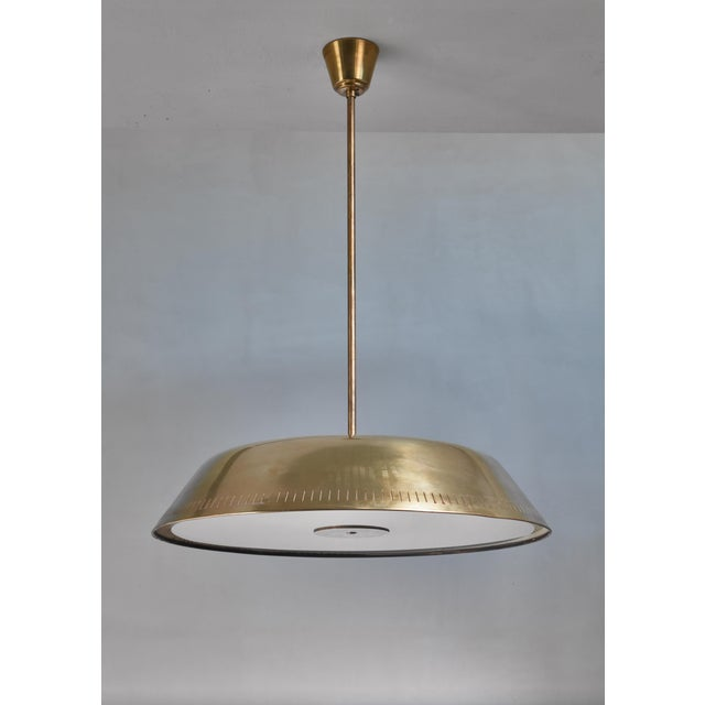 A large (63 cm diameter) pendant lamp attributed to Böhlmarks that functions both as uplighter as giving light downwards....