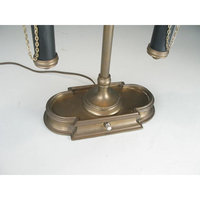 A very handsome vintage 1970s double light brass Bouillotte table lamp, with adjustable tole double shade, and chain...
