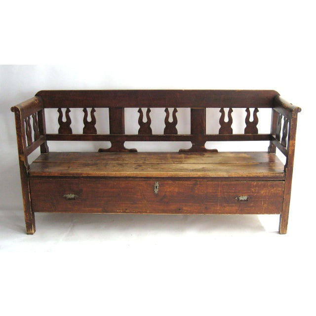 Beautiful antique bench with bottom drawer. Drawer has two metal pulls, and a lock, no key. Faux wood graining throughout,...