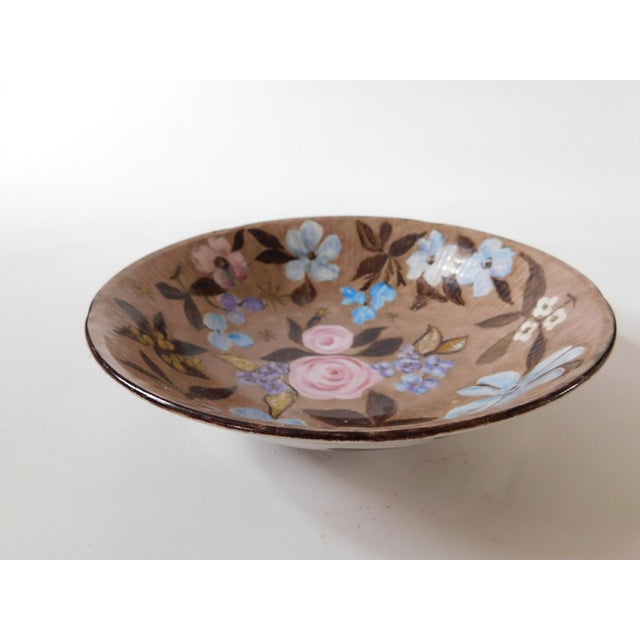 This charming porcelain bowl has beautiful little pink and blue flowers mixed with touches of gold here and there, all on...