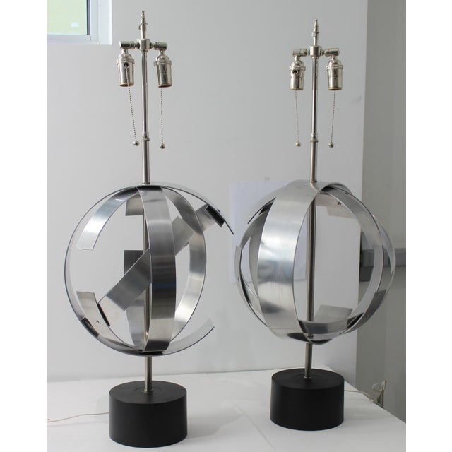 Stylish Armillary shaped table lamps in stainless steel. Each one is styled slightly differently in this modernist...