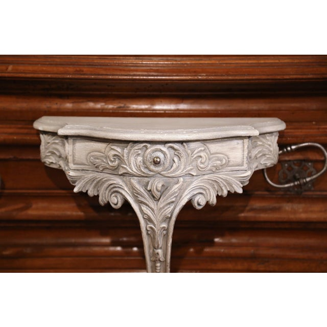 Place a vase or a bust on this elegant antique wall hanging bracket. Crafted in France, circa 1920, the bow front console...