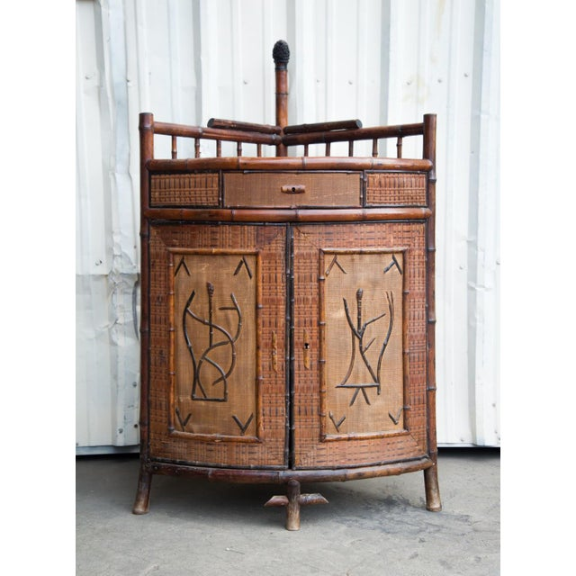 This true antique English Victorian cane, rattan, and bamboo corner bar  cabinet exemplifies the - Antique English Victorian Bamboo Bar Cabinet Chairish