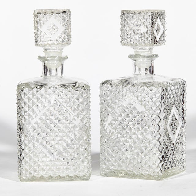 1960s pair of textured square glass decanters with matching stoppers. No maker's mark.