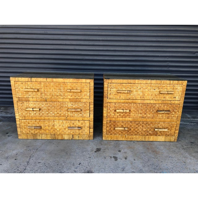 Vintage pair of woven wrapped rattan 3 drawer chests. Woven caning design with rattan handles. The exterior of the chests...