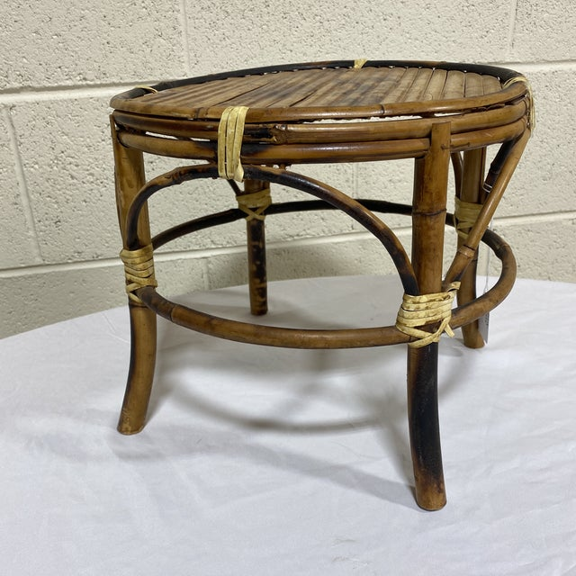This is the cutest little bamboo stool stand. I liken it to a purse stand when you're dining out. Burnt bamboo. Definitely...