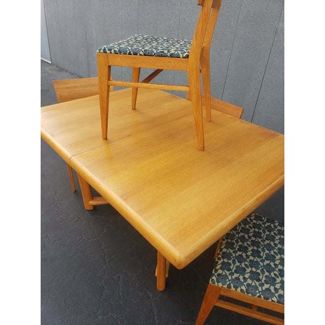Beautiful mid century dining set. Solid maple set with 4 chairs. It is in great condition! Has minimal wear consistent...