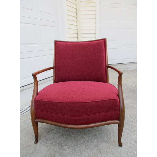 A beautifully restored and newly upholstered T.H. Robsjohn Gibbings for Widdicomb lounge chair and matching ottoman. This...