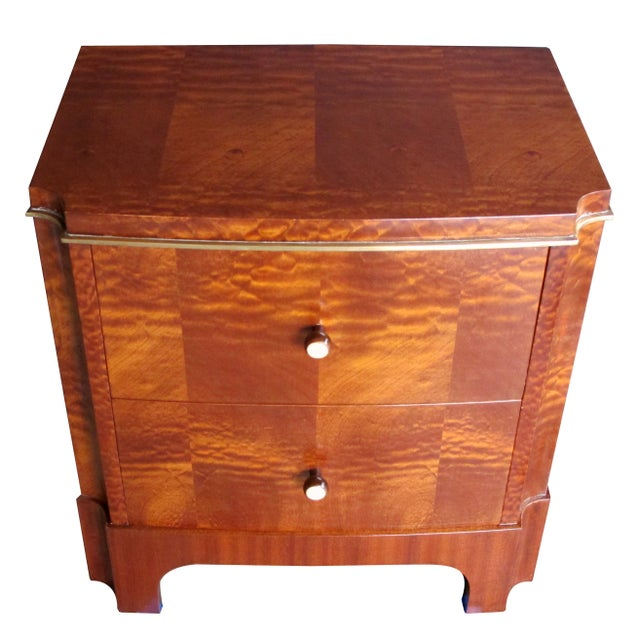 A good pair of French Art Deco mahogany two-drawer commodes; each of well-figured tiger mahogany fitted with two drawers...