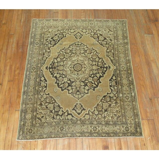 A 19th Century small size Persian Tabriz Rug with a classic medallion design on a brown field. Professionally Cleaned and...