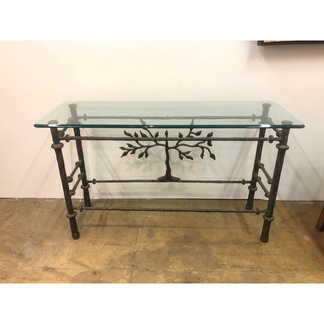 Beautiful brutalist console table, with glass top and tree of lie design. In the style of Alberto Giacometti.