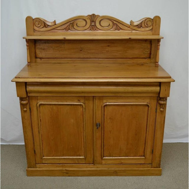 This is a charming little country chiffonier. The pine base features two paneled doors opening to a generous interior,...